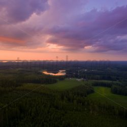 Midsummer sunset dramatic clouds colourful aerial - Arto Tommiska