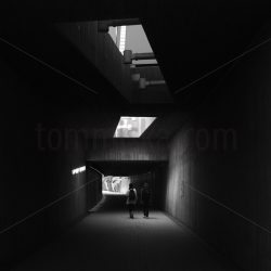 B&W people walking in tunnel - Arto Tommiska